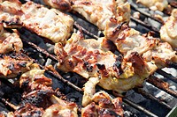 Chicken meat on a charcoal grill