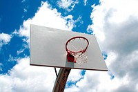 an image of a Basketball hoop against a cloudy sky
