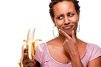 Beautiful black woman eating a banana fruit