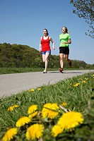 Two recreational runners, young women, 25_30 years, jogging