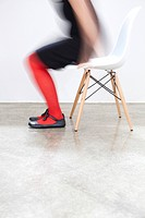 Woman getting up from a chair, motion blur