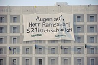 Protest against the Stuttgart 21 train station project, activists unfurl a huge banner at the municipal library, Augen auf Herr Ramsauer, S21 ist eh s...