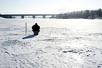 Winter fishing on the river in the sunshine day
