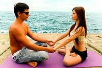 Lovely couple meditate