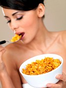 Portrait of beautiful woman, she eating cornflakes