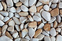 Light grey and brown smooth river pebble background textured