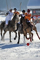 Polo players in a tough battle for the ball, left to right _ Ignacio Garrahan and Marie_Jeanette Ferch of team Parmigiani and Mark Haenni of team Kitz...