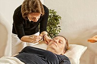Woman getting acupuncture treatment, Traditional Chinese Medicine