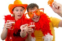 Two Dutch soccer fans in orange outfit cheering for the WK games, over white background