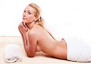 picture of beautiful blonde lady topless wearing white towel