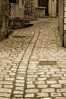 Narrow cobblestone street in the city of Hvar, Croatia