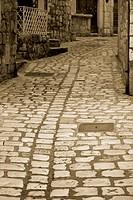 Narrow cobblestone street in the city of Hvar, Croatia