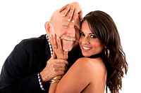 Rich elderly man with Hispanic gold_digger companion or wife