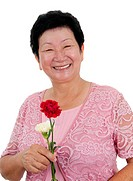 Happy Asian grandmother with carnation flowers on white background