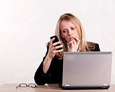 Attractive thirties caucasian blonde businesswoman with laptop