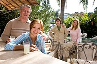Portrait of family relaxing on outdoor patio