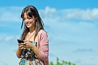 Pretty girl with cell phone in outdoors