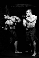 MMA _ Mixed martial artists fighting _ punching