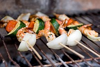 Shrimp skewers on a barbecue