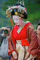 A participant in the Arashiyama Maple Leaf Festival dressed up as the 'Tayu', the highest class prostitute in Shimabara, Kyoto doing the tea ceremony