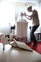 Wedding preparations, bridal shoes in front of a bride being styled