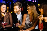 Man talking to women at bar