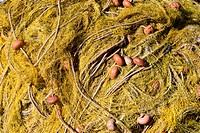 Yellow fishing net in pile