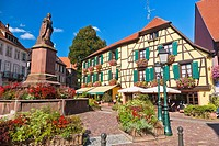 Fountain and picturesque houses in the village of Ribeauvillé, Alsace, France, Europe