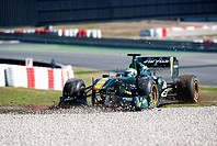 Heikki Kovalainen, Finland, with his Team Lotus_Cosworth T128 race car in the gravel, motor sports, Formula 1 testing on the Circuit de Catalunya race...