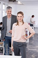 Germany, Bavaria, Munich, Man and woman in office, smiling, portrait