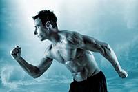 Muscular man posing by ocean