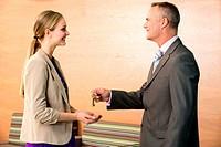 Estate agent giving keys to customer