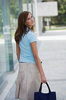 Woman with pocket book looking back