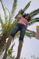 Woman with shopping bags jumping (thumbnail)