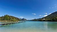 Austria, Fuschl, View of beach resort and Fuschl castle at lake Fuschlsee