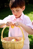 Little boy with Easter egg basket