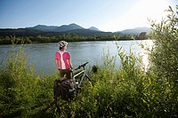 Austria, Carinthia, Mid adult woman standing by River Drau