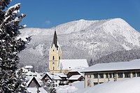 Austria, Styria, Bad Mittendorf steeple with snow covered mountain in background