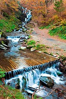 Waterfalls on Rocky Stream, Running Through Autumn Mountain Forest
