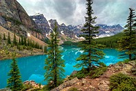 The incredible turquoise blue water of Moraine Lake in Banff National Park in Alberta Canada. The amazing color is natural and is caused by light refl...