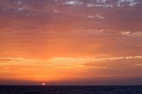 Sunset setting in the ocean