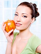 Young beautiful sensulity woman with apple _ indoors