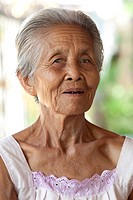 Portrait old grey haired woman, Asia, with many folds in the face