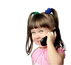 The little girl with a mobile phone. It is isolated on a white background