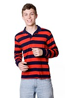 Studio portrait of teenaged Caucasian boy smiling with hands up on white background