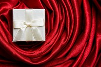 White luxury gift box on red satin