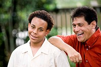 African American teenage boy with his proud Hispanic father