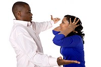 Studio portrait of middle aged African American couple arguing on white background
