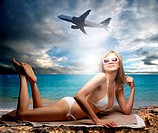 beautiful girl on the beach and a flying airplane