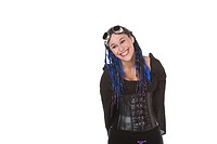 Studio portrait of young Caucasian goth woman smiling on white background